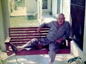 Pappaw on his front porch swing. He spent many hours there, waving to people passing by.